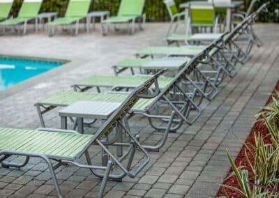 Summerwood Apartments poolside lounge chairs